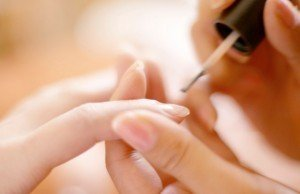 Painting Fingernails --- Image by © Royalty-Free/Corbis